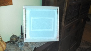 Back picture of dress frame with Aida attached