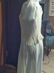 side view finished corset on dress form
